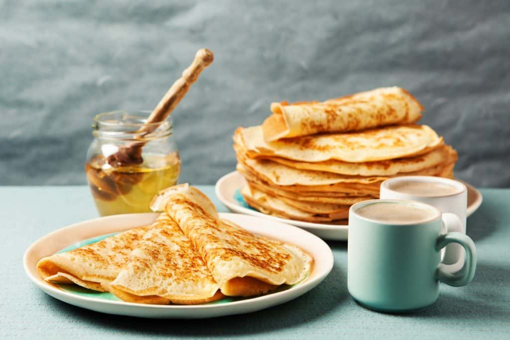 crepes on a plate with honey