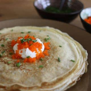 Blini style crepes with sour cream, caviar, and chives