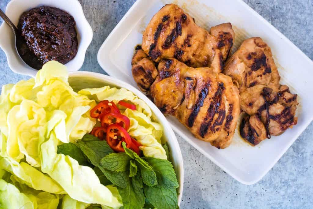 grilled chicken in spicy gochujang sauce with mint and lettuce leaf wraps