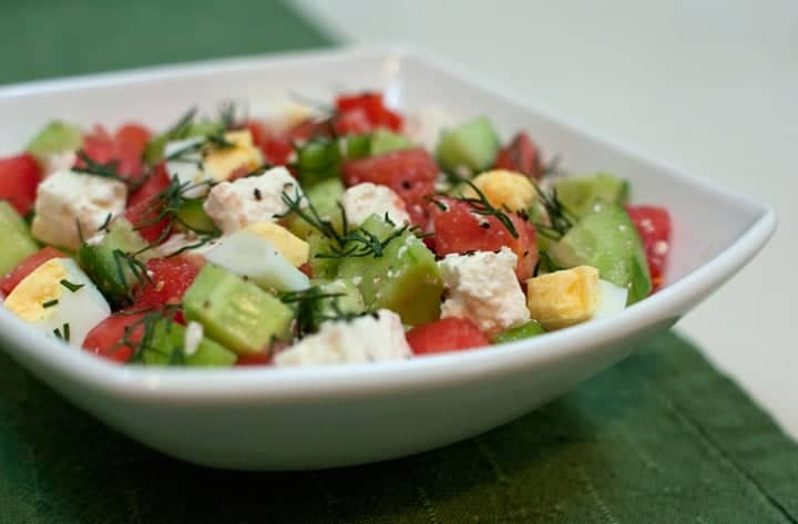 Israeli salad with cucumbers, tomatoes, dill, hard boiled egg, and feta cheese