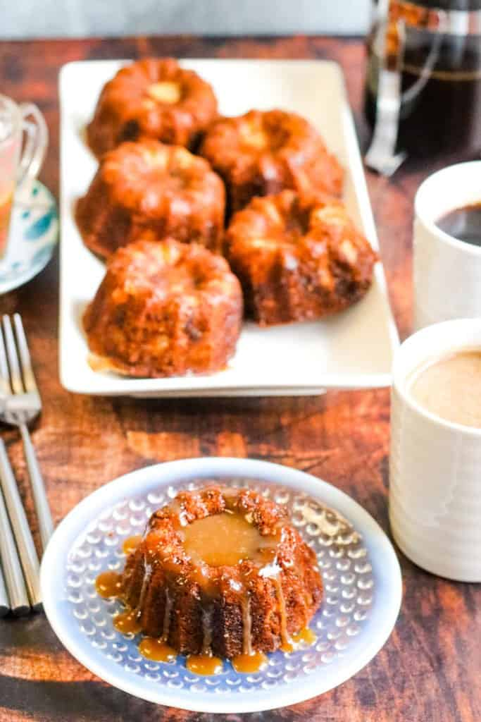 sticky toffee pudding with toffee sauce ready to eat with coffee