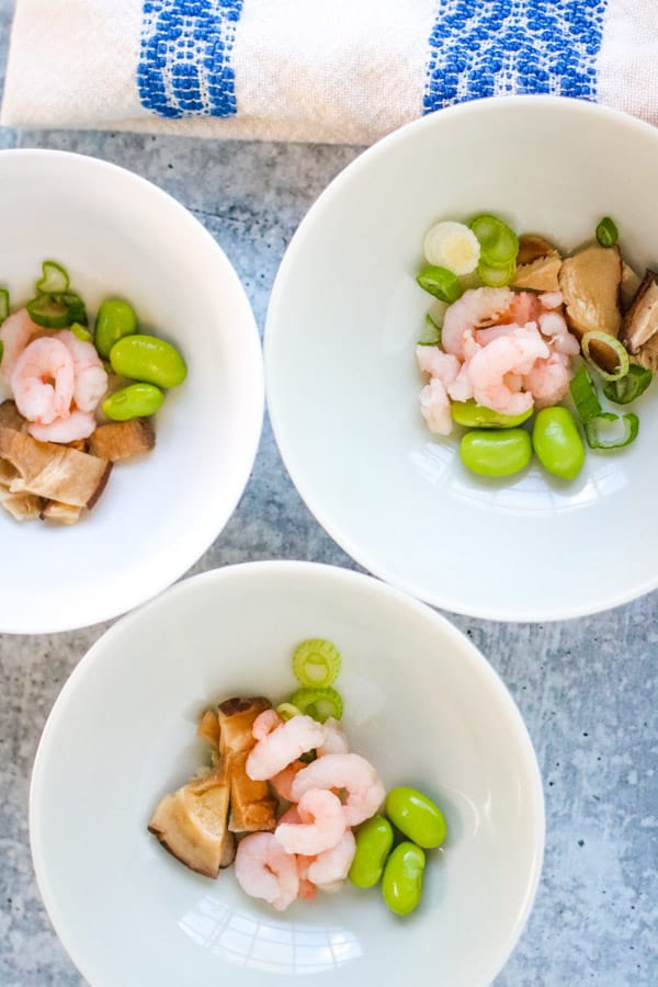 shrimp, mushrooms, edamame, scallions in bowls