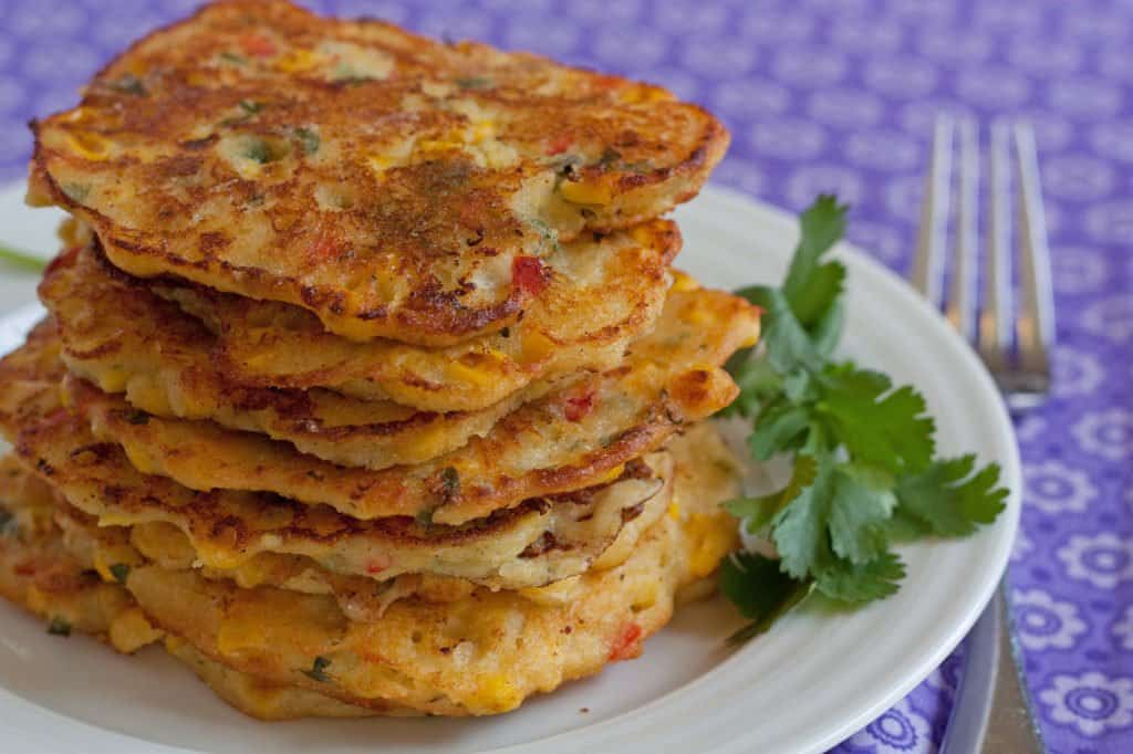 Spicy corn cakes stacked on a plate