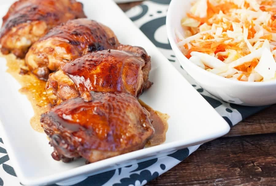 honey sriracha glazed chicken thighs on a serving platter
