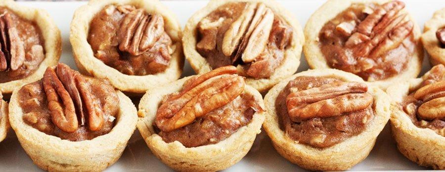 platter of gluten free pecan pie tartlets on a plate
