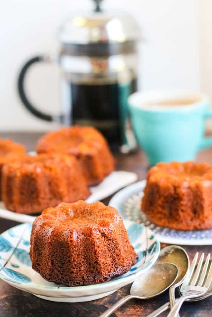 Honey cake baked in a mini bundt pan on little plates with coffee