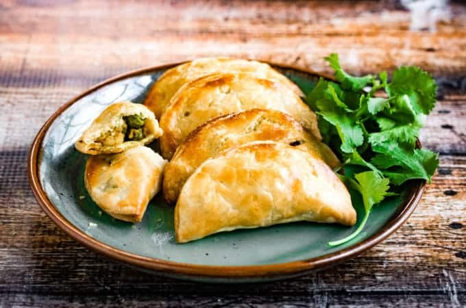 Thai curry puffs are made of flaky puff pastry filled with a flavorful mix of ground chicken, onions, garlic, potatoes, peas, and spices