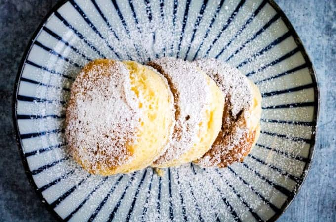3 light and fluffy japanese souffle pancakes on a japanese ceramic plate