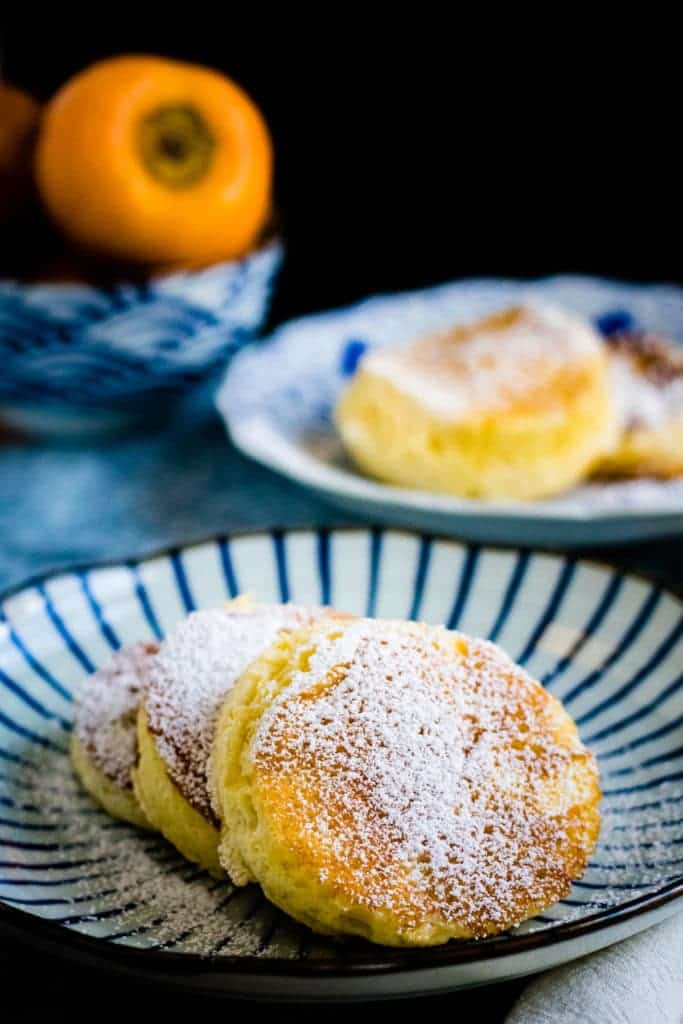 fluffy japanese souffle pancakes on a striped japanese plate
