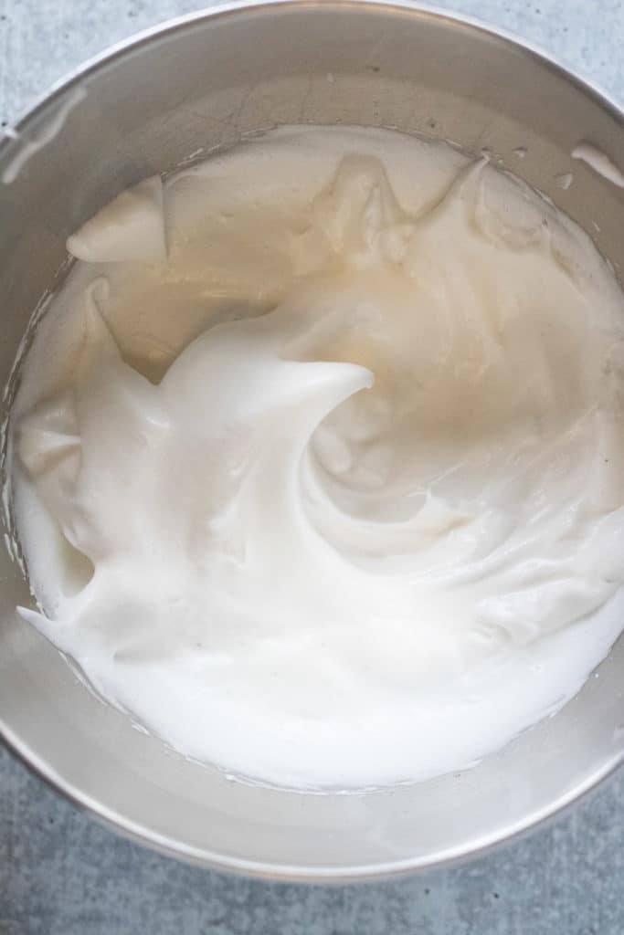 egg whites whipped to a fluffy meringue and ready to be folded into the rest of the batter for souffle pancakes.