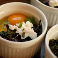Baked Eggs with Crème Fraiche, Greens, and Goat Cheese