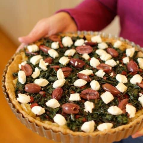 Savory tart with Greek olives, goat cheese, greens and an olive oil pastry crust