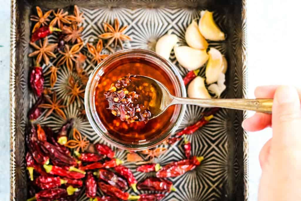 how to make chili oil with dried chilies, oil, garlic, and star anise