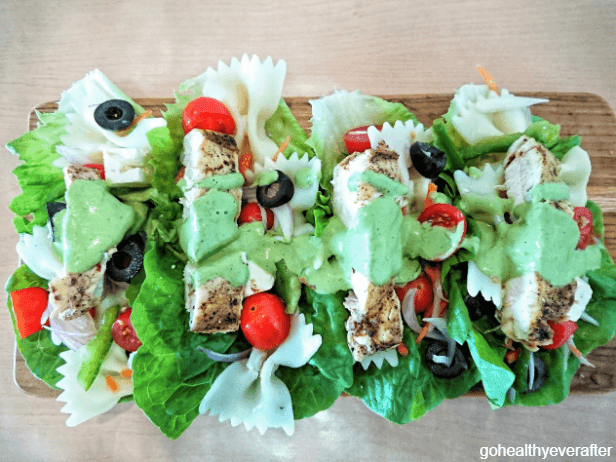 Lettuce wraps with chicken, pasta salad and mint yogurt sauce