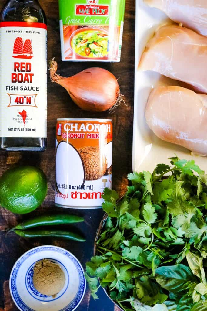 ingredients for thai green curry chicken laid out on a table