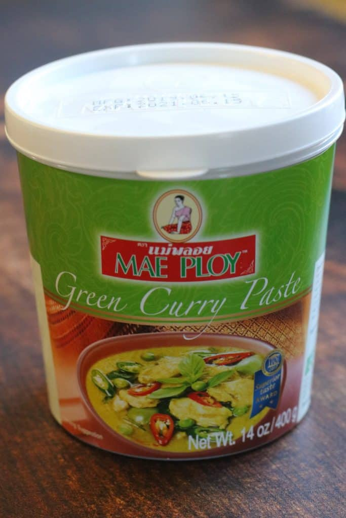 A contiainer of Mae Ploy brand Thai green curry paste