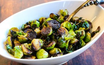 crispy brussels sprouts in a white serving bowl