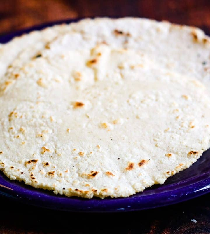 homemade corn tortillas on a purple plate