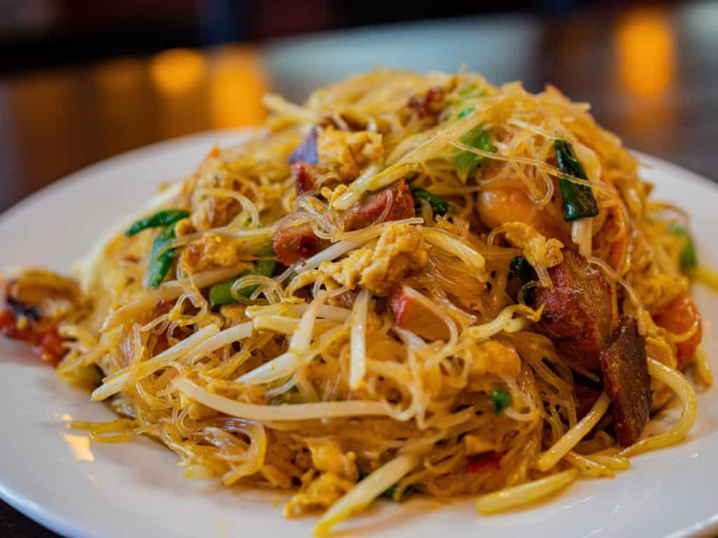 singapore rice noodles on a white plate